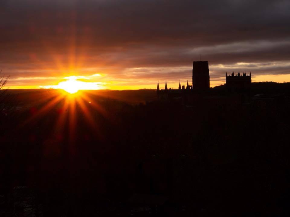 sunrise photo from wharton park durham with durham cathedral silhouetted against the red clouds 3