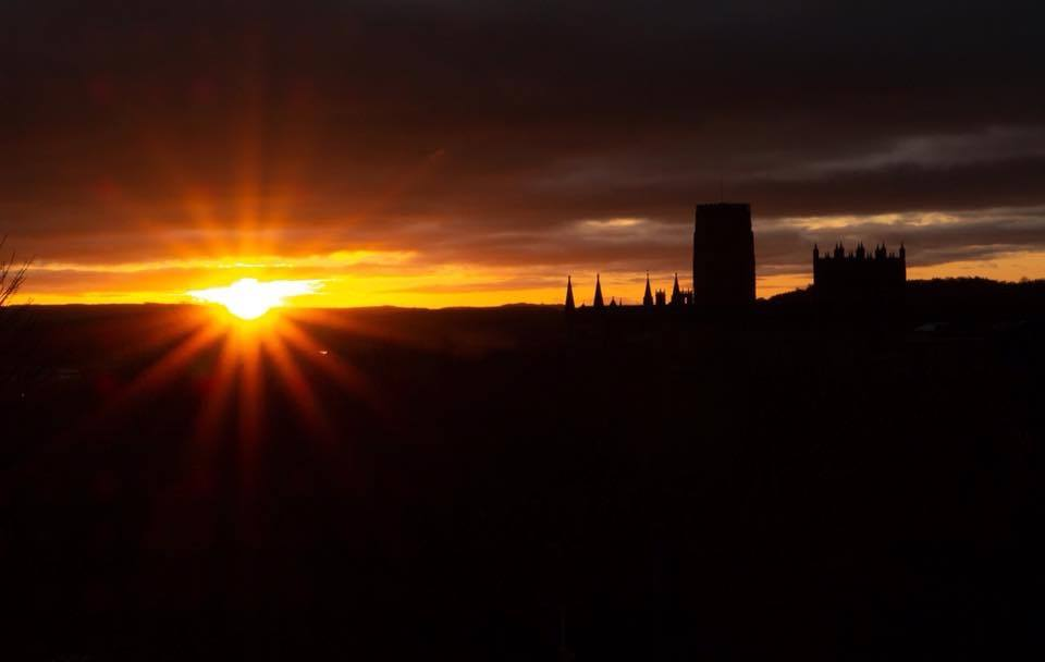 sunrise photo from wharton park durham with durham cathedral silhouetted against the red clouds 2
