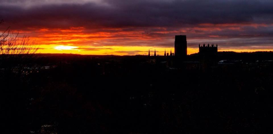 sunrise photo from wharton park durham with durham cathedral silhouetted against the red clouds 1