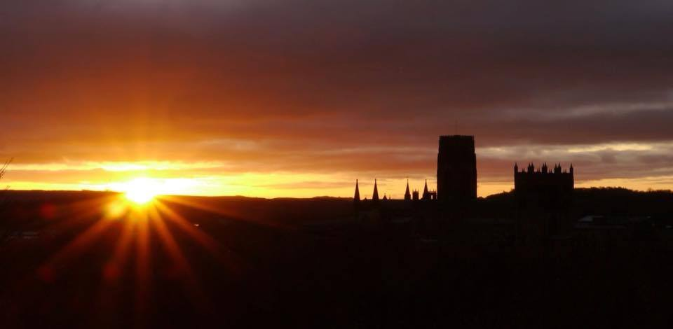 sunrise photo from wharton park durham with durham cathedral silhouetted against the red clouds 4