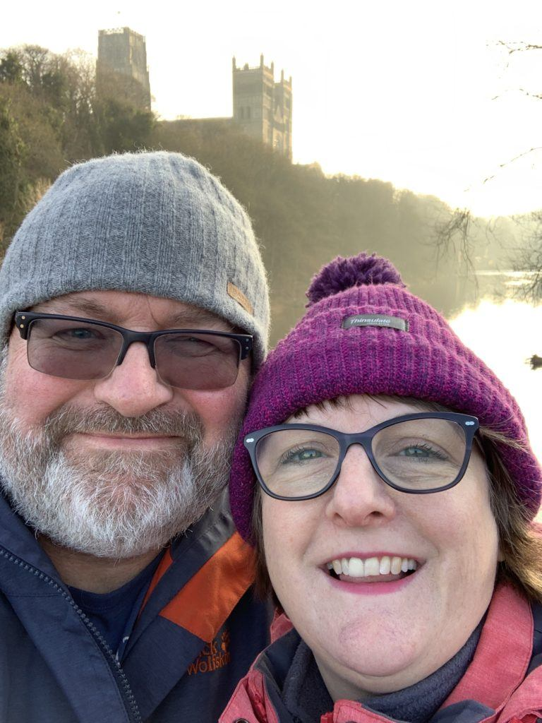 picture of dave and debbie on framwelgate bridge with durham cathedral in the background