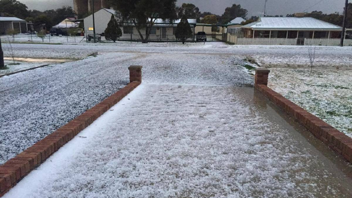 Moderate hail whitens the ground